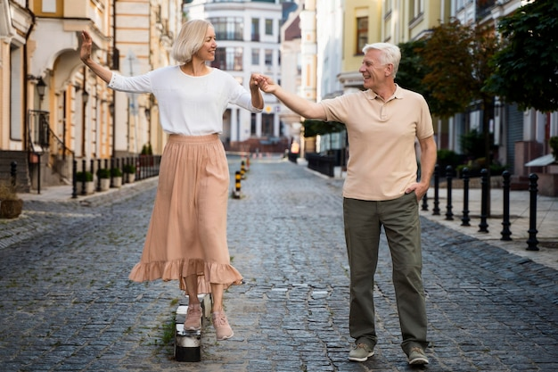 Front view of smiley senior couple enjoying a walk outdoors Free Photo