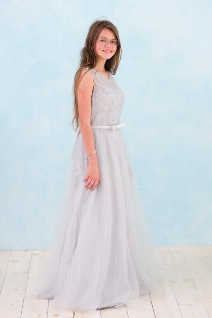 Front view of smiling girl wearing elegance dress Free Photo