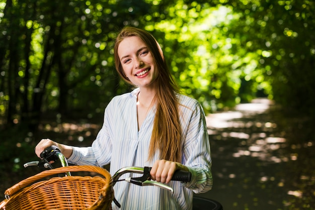 Front view smiling woman on bike Free Photo