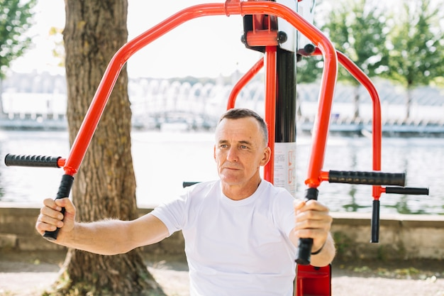 Front view sportive man working out Free Photo