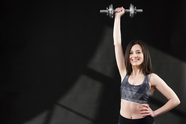 Front view of sporty woman with dumbbells Free Photo
