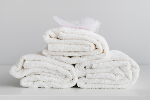 Front view stacked white towels Free Photo