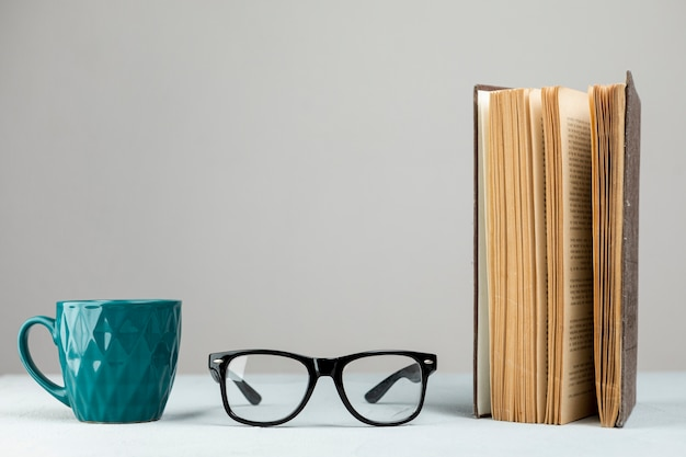 Front view standing book with glasses Free Photo
