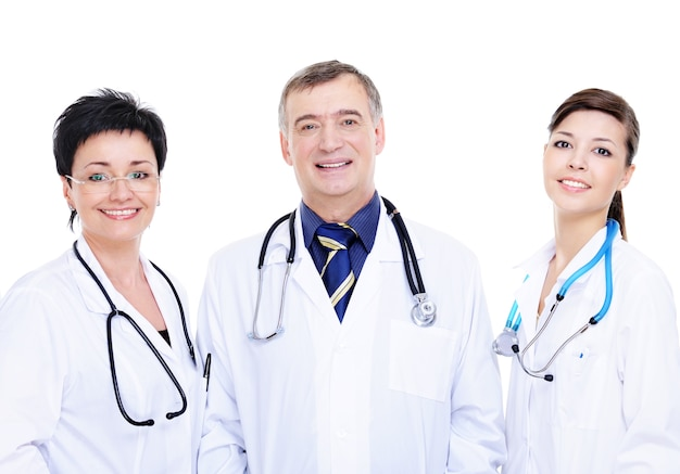 Front view of three happy medical doctors standing together Free Photo