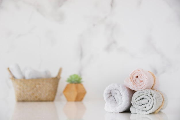 Front view towels set with basket on table Free Photo
