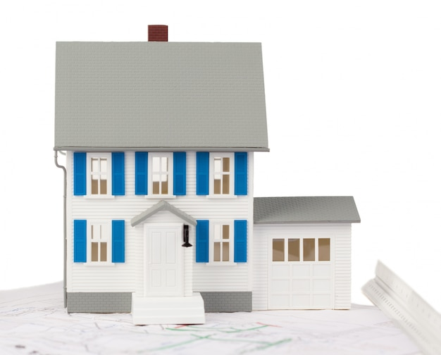 Front view of a toy house model on a ground floor plan Photo