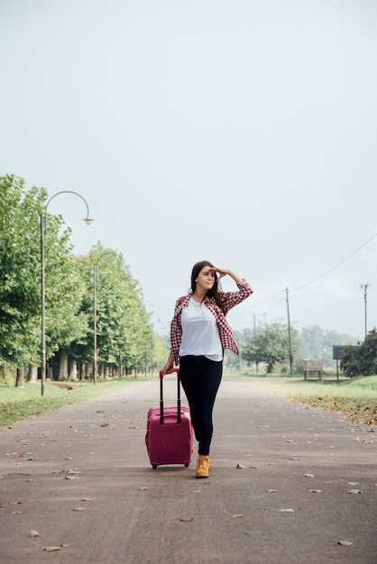 Front view of traveler with her baggage Free Photo