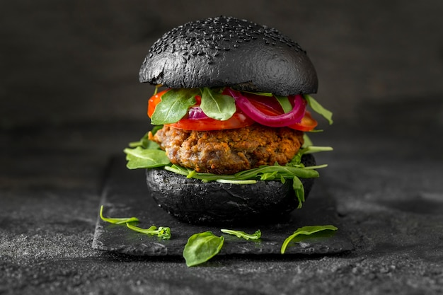 Front view veggie burger with black buns Free Photo