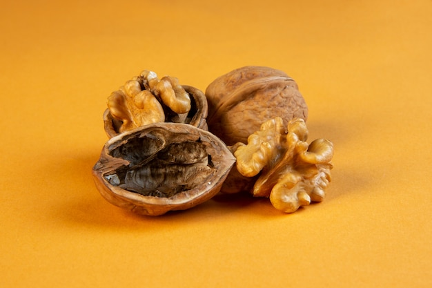 Front view walnuts on mustard Free Photo