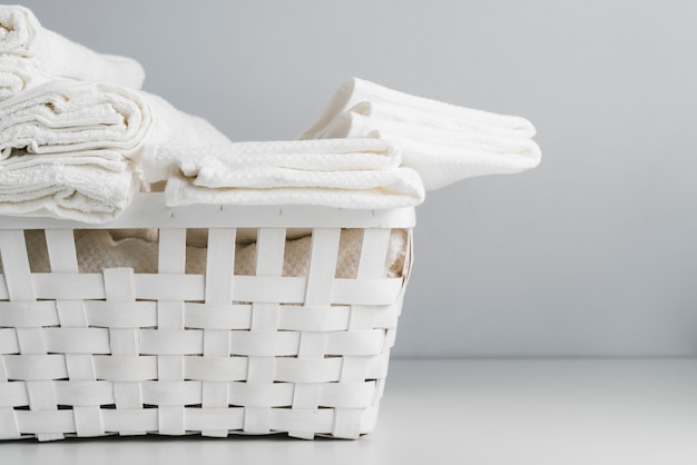 Front view white basket with towels Free Photo
