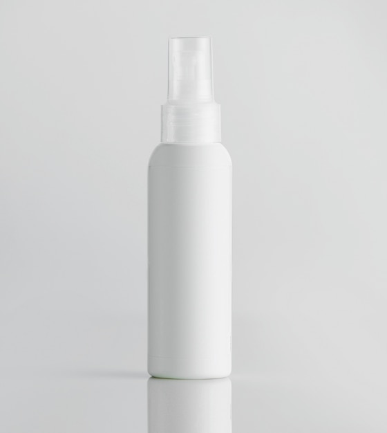 Front view white plastic bottle with sprayer on a white wall Free Photo