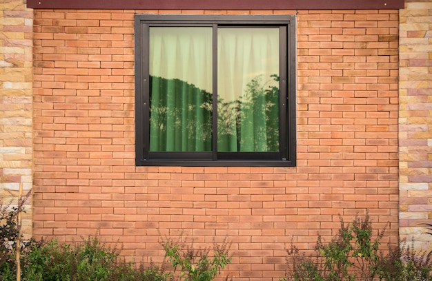 Front view of window exterior on brick wall Premium Photo