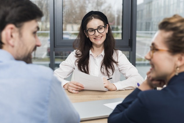 Front view of woman attending a job interview with human resources people Premium Photo