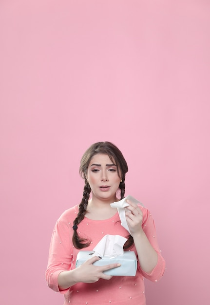Front view of woman crying and holding napkins with copy space Free Photo