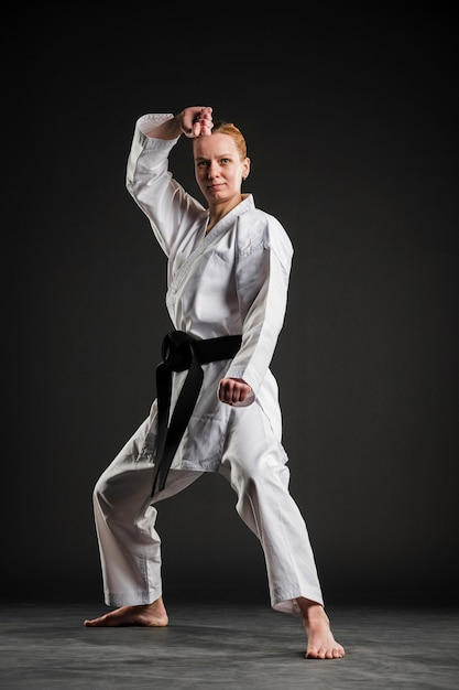 Front view woman doing karate pose Free Photo