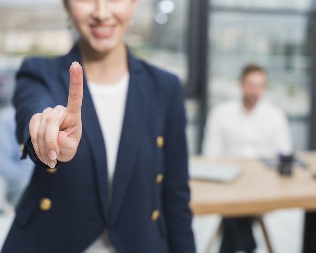 Front view of woman from human resources putting her finger up Premium Photo