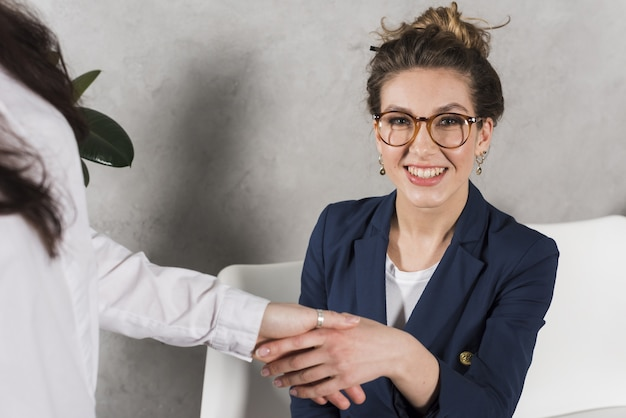 Front view of woman hand shaking human resources person Free Photo