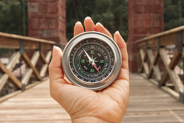 Front view woman holding compass Free Photo
