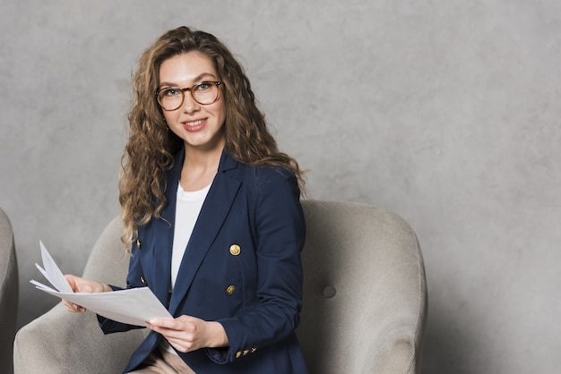 Front view of woman holding papers with copy space Premium Photo