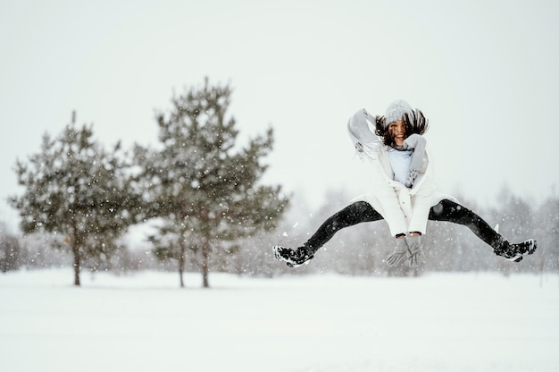 Front view of woman jumping in the air outdoors Free Photo
