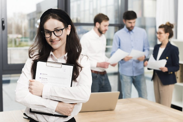 Front view of woman in the office ready to hold a job interview Premium Photo