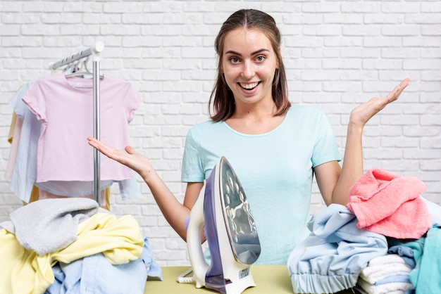 Front view woman ready for ironing clothes Free Photo