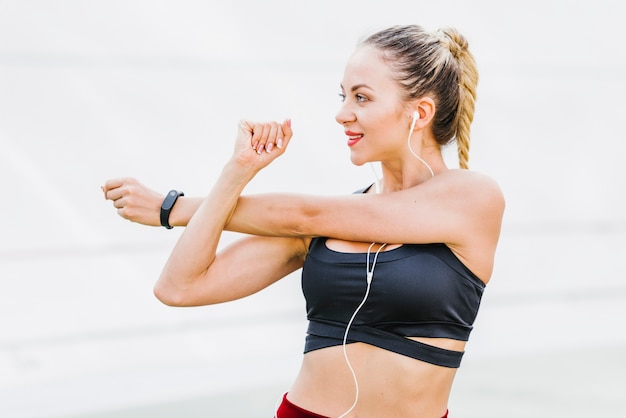 Front view of woman stretching arms Free Photo