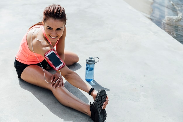 Front view of woman stretching Free Photo