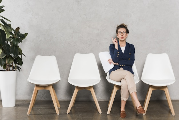 Front view of woman waiting for her job interview Premium Photo