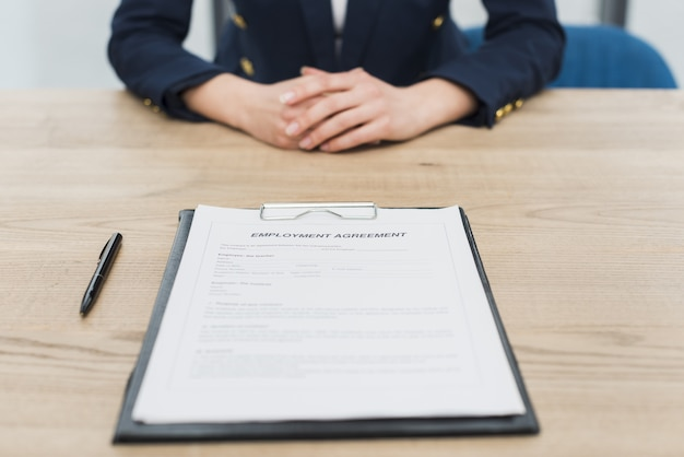 Front view of woman waiting for you to sign new contract Premium Photo