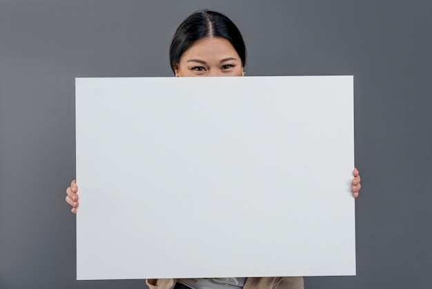 Front view woman with blank paper sheet Free Photo
