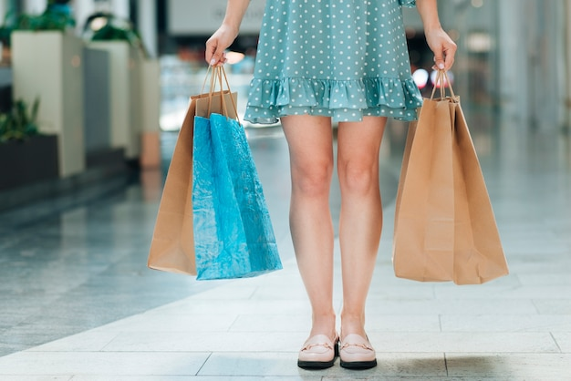 Front view woman with shopping bags Free Photo