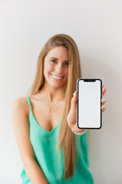 Front view women holding phone Free Photo