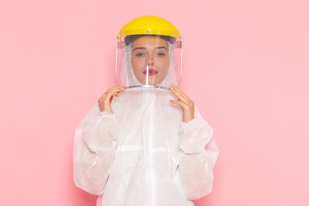 Front view young beautiful female in special white suit wearing protective helmet on the pink space special suit  girl woman Free Photo