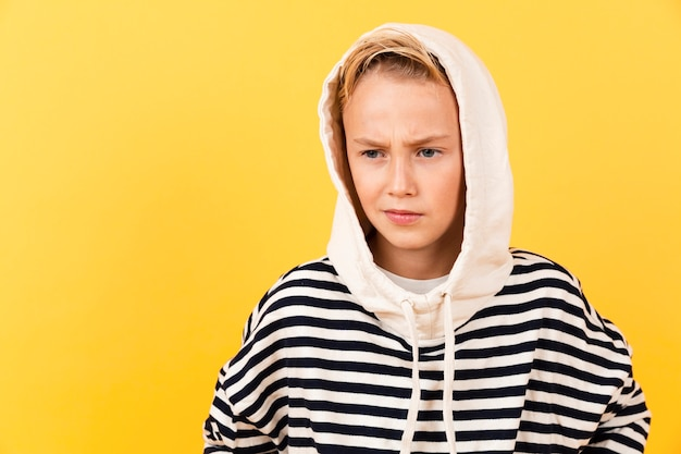 Front view young boy wearing hoodie Free Photo