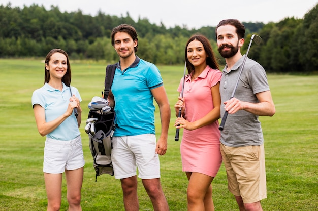 Front view of young golfers looking at camera Free Photo
