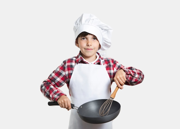 Front view young kid with a cooking pan Free Photo