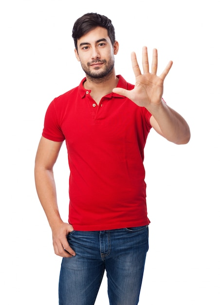 Front view of young man showing the open hand Free Photo