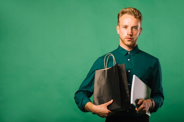 Front view young man with shopping bags Free Photo