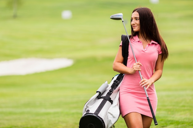 Front view young woman at the golf course Free Photo
