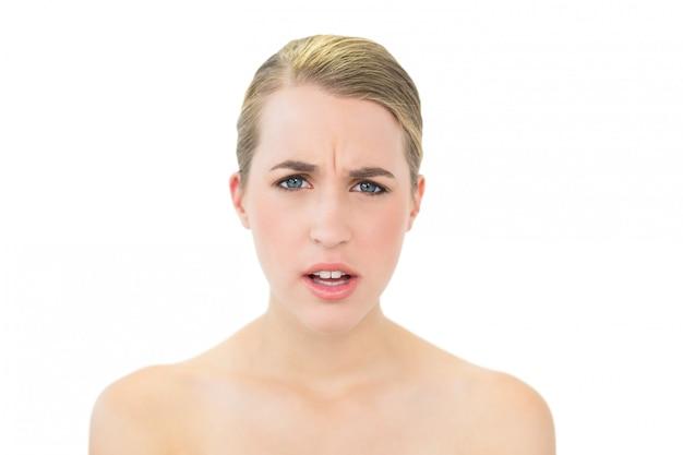 Frowning beautiful blonde posing Premium Photo
