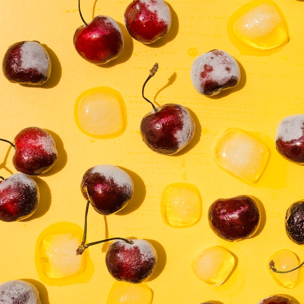 Frozen cherries and ice cubes Free Photo
