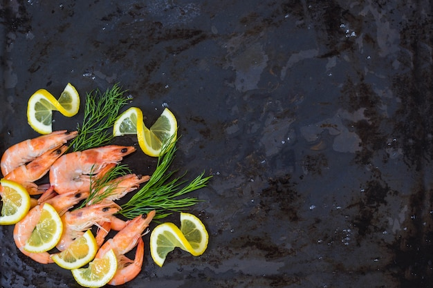 Frozen cooked shrimp to cooking with lemon dill and spices. background copyspace Premium Photo