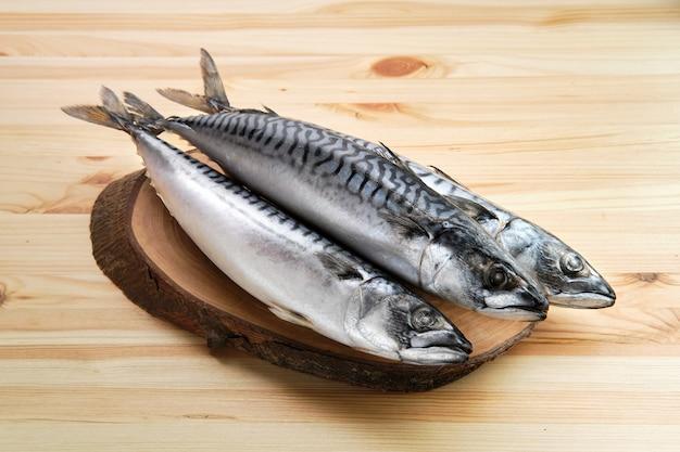 Frozen mackerel on wooden table Premium Photo