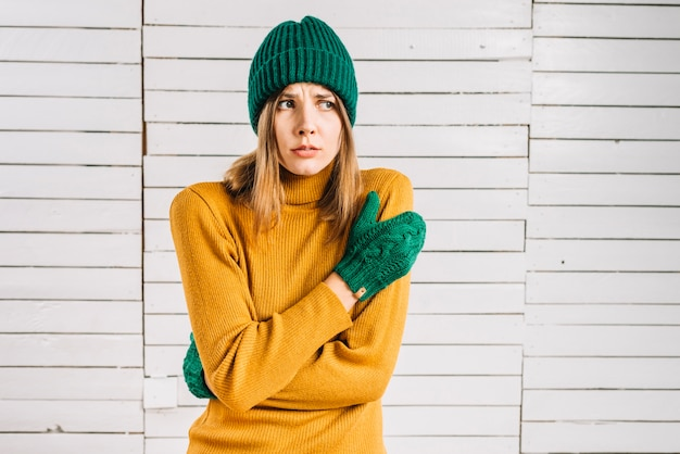 frozen woman in warm clothes photo free download