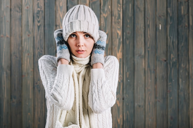 Frozen woman in light sweater Free Photo