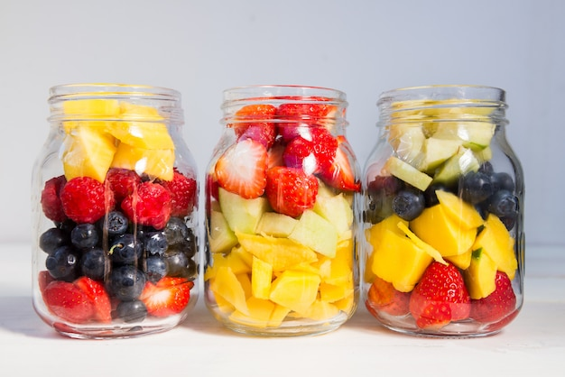 Fruit and berry salads in jars Premium Photo