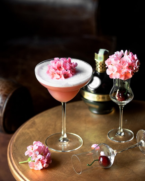Fruit cocktail topped with flowers Free Photo