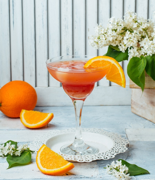Fruit cocktail with orange slice Free Photo
