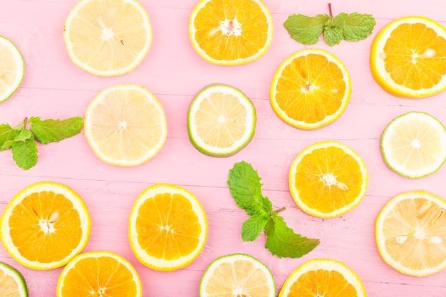Fruit. colorful fresh fruit on blue wooden board. orange, lemon,flat lay, top view, Free Photo